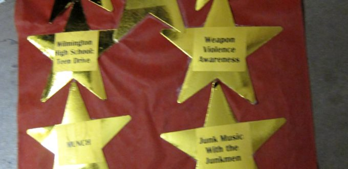 a field of gold foil stars with names